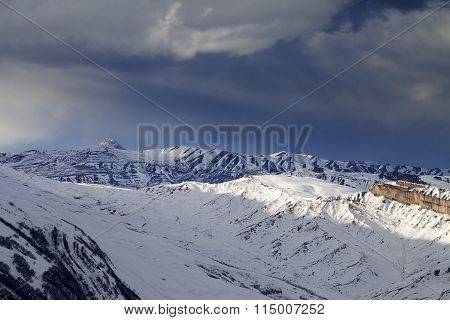 Winter Mountains At Evening And Storm Clouds