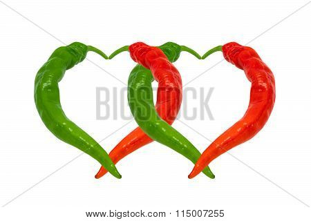 Red And Green Chili Peppers In Love. Hearts Composed Of Hot Peppers.