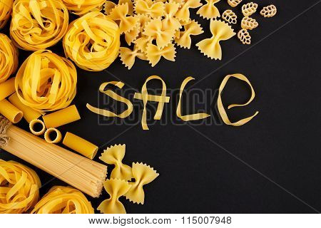 Word Sale From Pasta On The Black Background