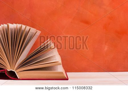 Composition with vintage old hardback books, diary, fanned pages