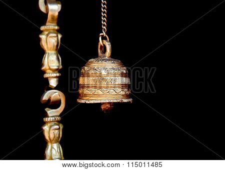 Bronze hindu holy bell against black background