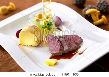 Roasted Venison With Polenta And Chanterelles