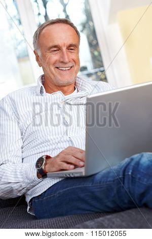 Mature Man With Laptop, Smiling