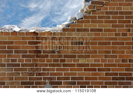 crumbling brick wall with cloud background