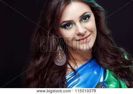 Beauty closeup portrait of a beautiful girl, blue green sari with peafowl feathers in the dress desi