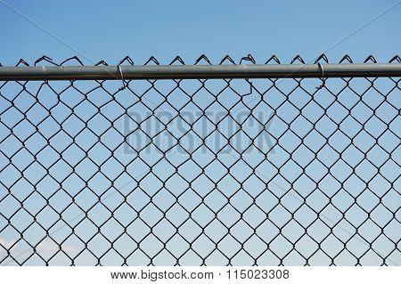 chainlink fence against blue sky
