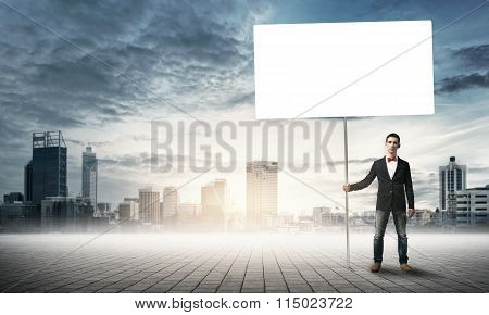 Guy with white billboard