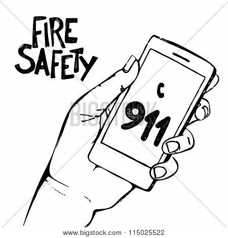 Hand holding mobile phone with number 911