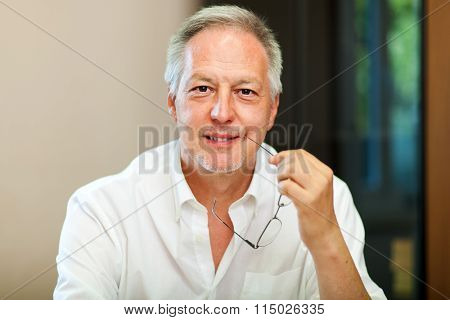 Businessman portrait holding glasses