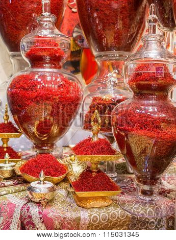 Tehran, Iran - December 6, 2015: Red Iranian saffron in glasses on market in Tehran, Iran