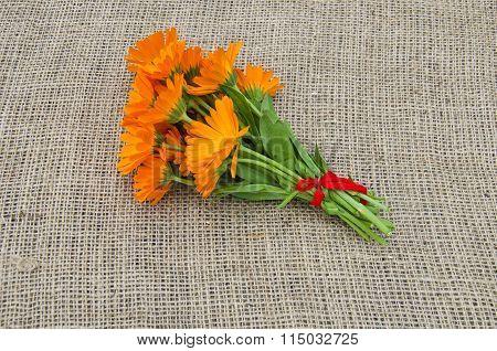 Bunch Of Marigold Calendula On Linen Material