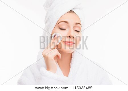 Pretty Girl With Towel On Her Head Wash Off Makeup Wiht Closed Eyes