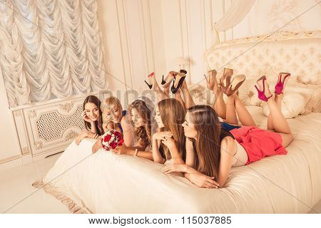 Girlfriends Lying On The Bed Showing Beautiful Legs