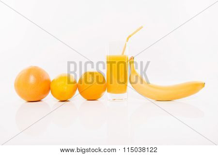 Range Of Orange Fruits And Glass Of Juice, Close Up Photo