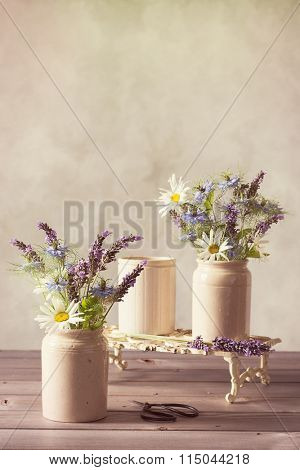 Spring flower arrangement in vintage ceramic pots