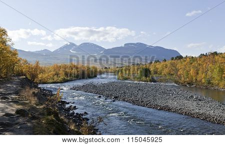 Short river up North. Colorful autumn, fall leaves in the taiga forest.