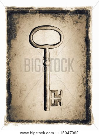 Old key ion a grunge distressed frame.