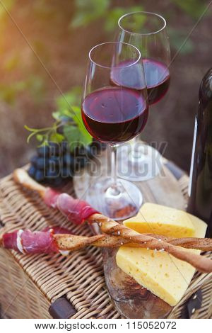 Two Glasses Of Red Wine With Bread, Meat, Grape And Cheese
