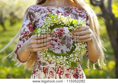 Young Woman Holding Wreath From Lily Of The Valley