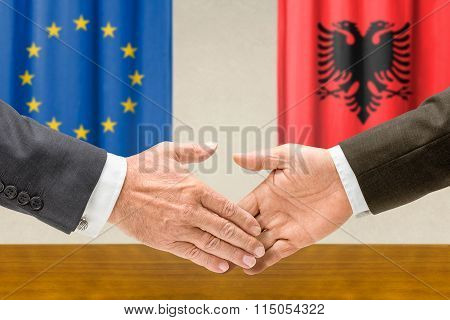 Representatives Of The Eu And Albania Shake Hands