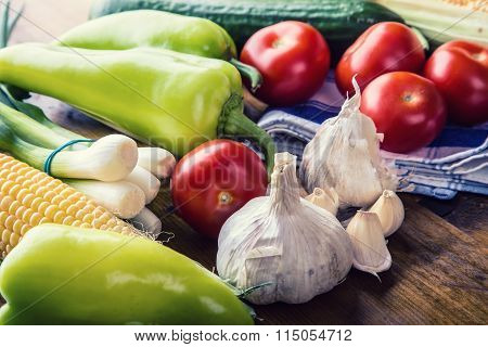 Fresh vegetables. Overhead view of a assortment of farm fresh vegetables, Green pepper, garlic, corn