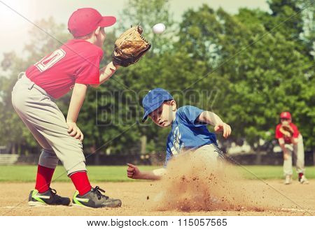Boy sliding into base during a baseball game with Instagram style filter
