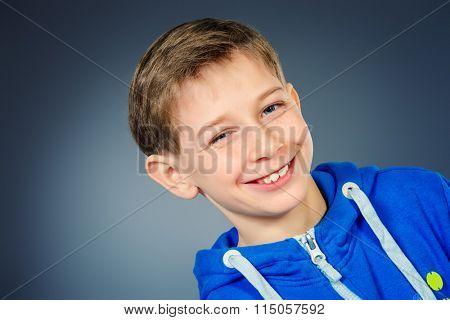 Portrait of a cheerful teen boy in casual sportswear. Studio shot.