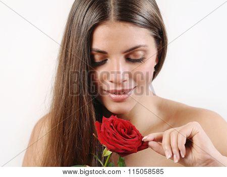 Cute Beautiful Woman Tears Off Petals Of Red Rose