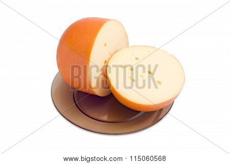 Two Big Pieces Of Cheese On A Dark Glass Dish