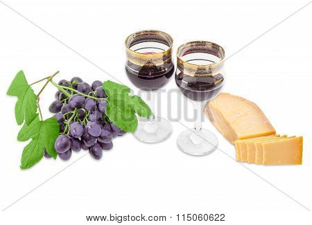 Two Wine Glasses With Red Wine, Cheese And Blue Grape