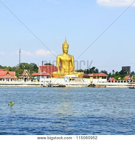 The View Of Big Golden Buddha Be Side The Chao Phraya River At Koh Kret ,nonthaburi ,thailand .