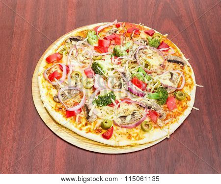 Vegetarian Pizza With Vegetables, Mushrooms And Olives On Wooden Surface