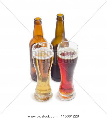 Two Beer Glasses And Two Bottles Of Various Beer