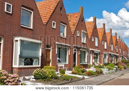 Volendam, Netherlands - August 15, 2011, row of typical Dutch family houses