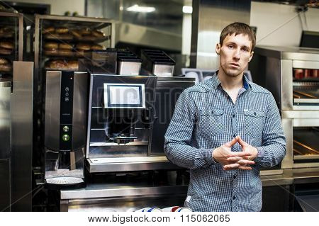 Barista standing with coffee maker