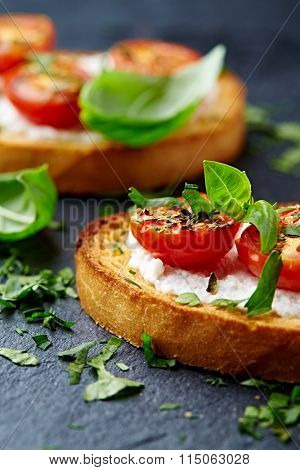 Crostini with cherry tomatoes and ricotta