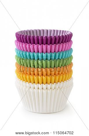 Stack of colorful cupcake cases isolated on a white background