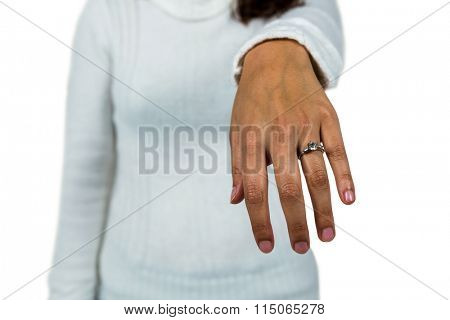 Mid section of woman wearing ring against white background