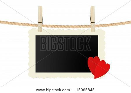 Old Photo Card With Red Hearts Hanging On Rope Isolated On White