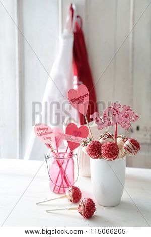 Red and white cake pops with decorations for Valentine's Day