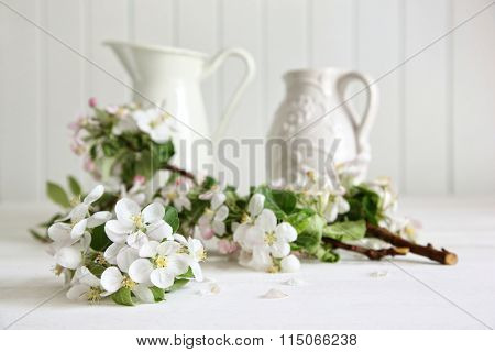 Apple tree branches in a vase on table
