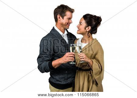 Happy romantic couple with champagne flute against white background