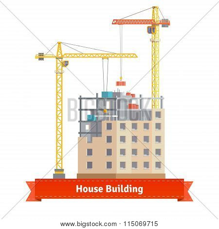 Construction of tenement house with tower cranes