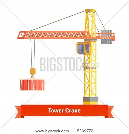 Tower crane lifting building materials on the hook