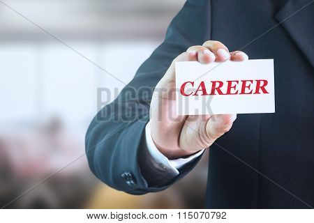 Businessman holding a white sign with the message CAREER.