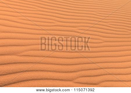 Sand Desert Background With Wind Ripple - Concept Of Purity And Pristine Unspoiled Travel Destinatio