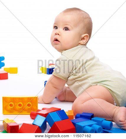 Little Boy With Building Bricks