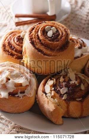 Cinnamon Rolls With Almond Macro On A Plate And Coffee. Vertical