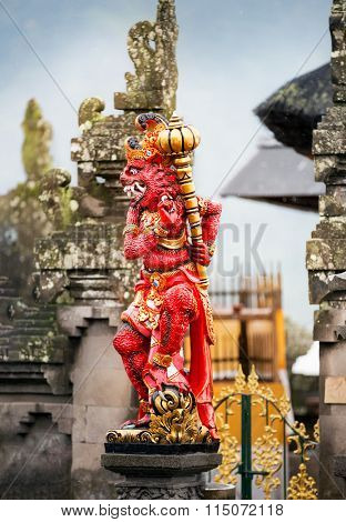 Demon statue in form of big cat at  temple in Bali , Indonesia