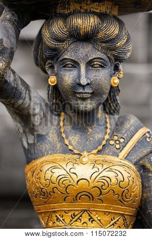 goddess statue in Hindu temple, stone statue with golden Detail